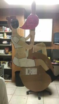 Created a lifesize Miley Cyrus out of retail boxes and added coworkers' faces to it